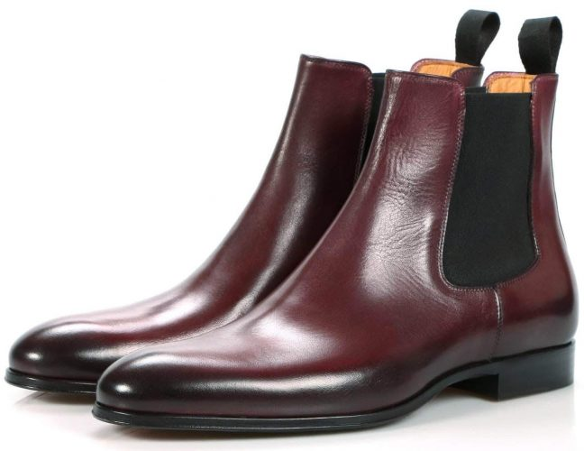 A pair of burgundy Thomas Bird boots.