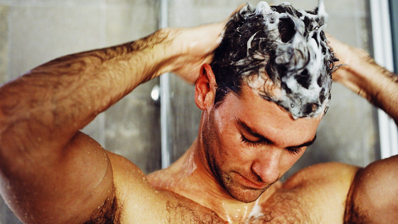 A man washing his hair with a troth.