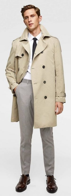A beige Zara trench coat, the model's hand in his right pocket.