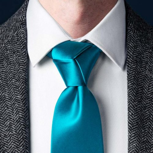 The Trinity knot it a bit too flashy for business formal attire.