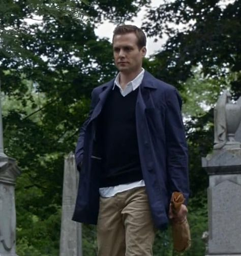 A blue raincoat not in line with other Harvey Specter casual style.