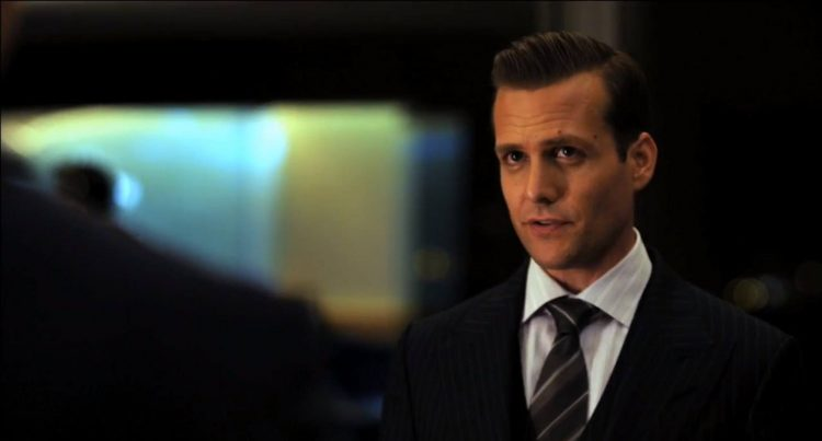 Harvey Specter's slicked back haircut in the first episode.