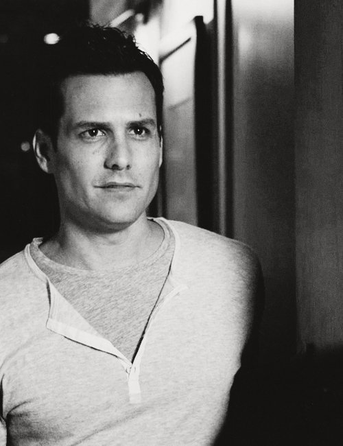 Casual Harvey Specter style in a henley.