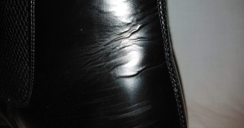 Leather wrinkles on the back of the Chelsea Boot.