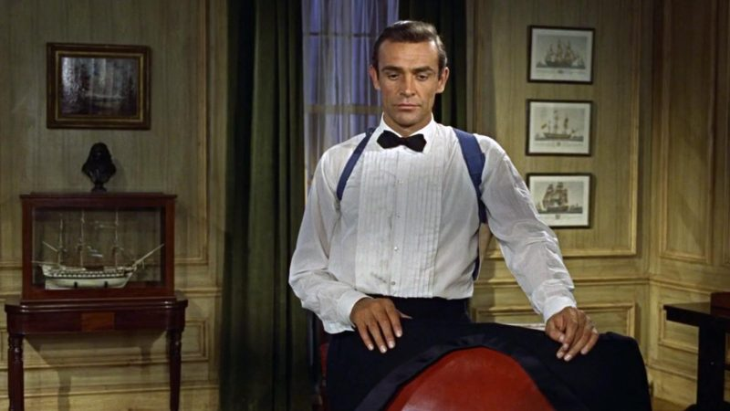 Sean Connery in Dr No wearing the pleated tuxedo shirt style.