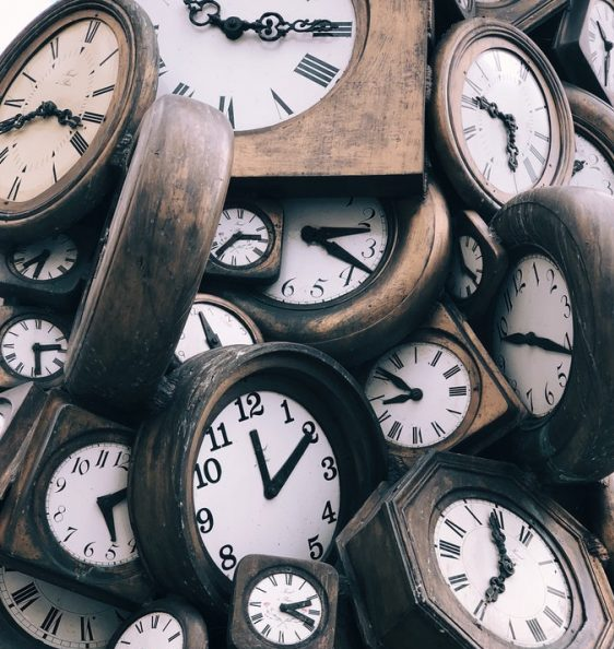 A sea of clocks at different times.