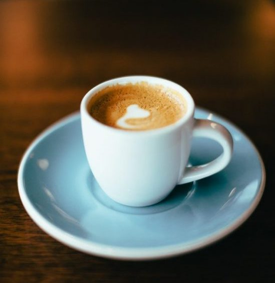 A coffee on a plate. A way of how to wake up early.