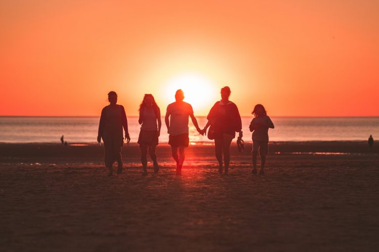 A family walking together who dont wake up early.