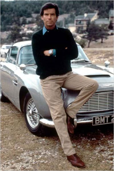Piece Brosnan in 1995's Goldeneye leaning against the DB5.
