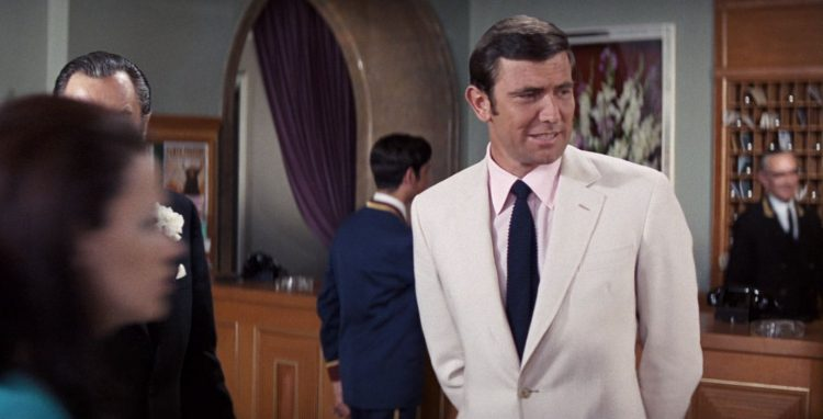 James Bond style - White suit with a pink shirt.