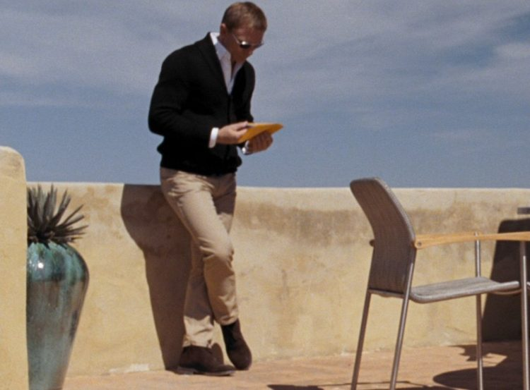 James Bond style displayed in his Quantum of Solace cardigan.