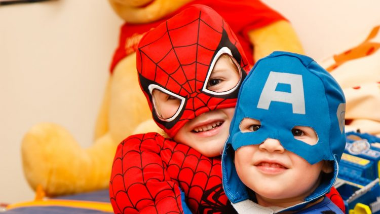 children in a Spiderman and Captain America costume.