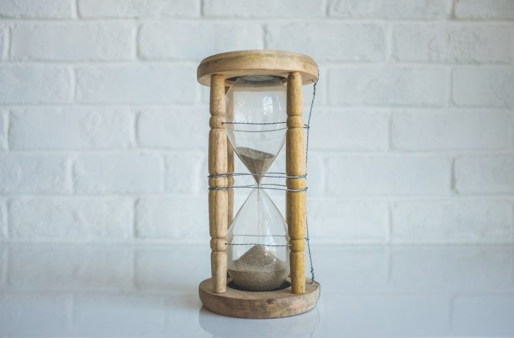Proactivity mindset hourglass running out.