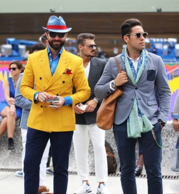 Two men in bold suits. Stop wasting your money on clothes.