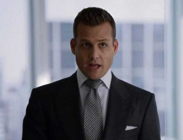 Harvey Specter with an oversized Windsor knot.