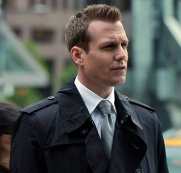 Harvey Specter style includes a trench coat.