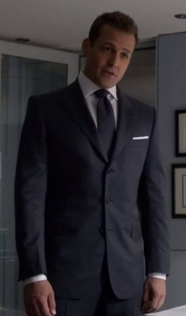 Harvey Specter in a three button suit.