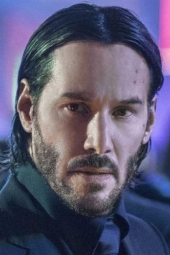 John Wick's slicked back hair.