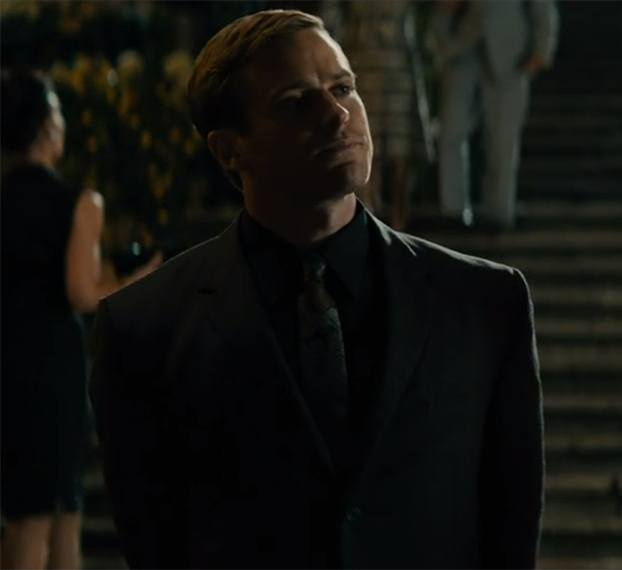 Armie Hammer as Illya Kuryakin in a suit