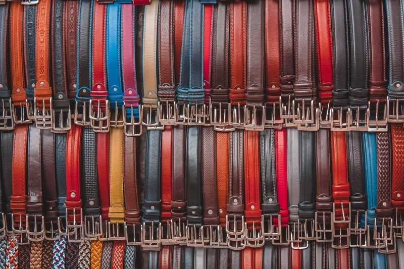 A collection of colourful belts.
