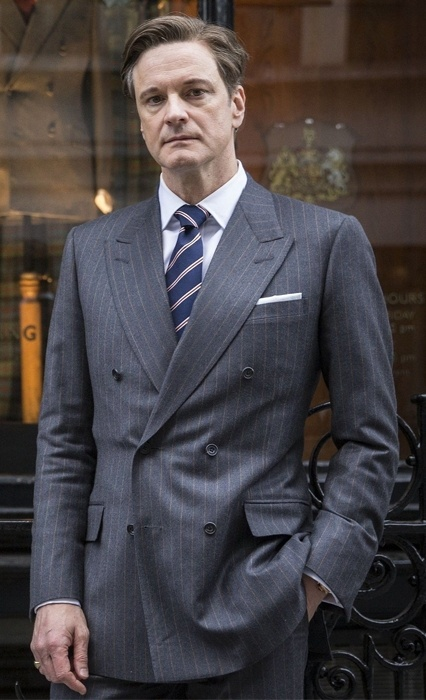 Colin firth standing in a Kingsman suit