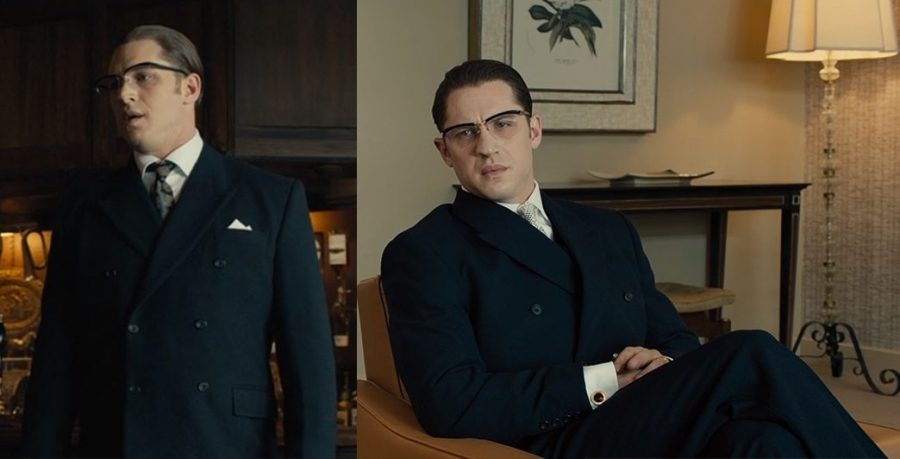 Ronnie Kray in a navy double breasted suit.