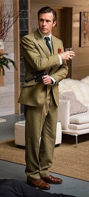 Jack Davenport in a olive suit