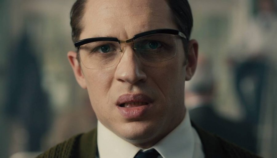 Ronnie Kray wearing browline glasses.