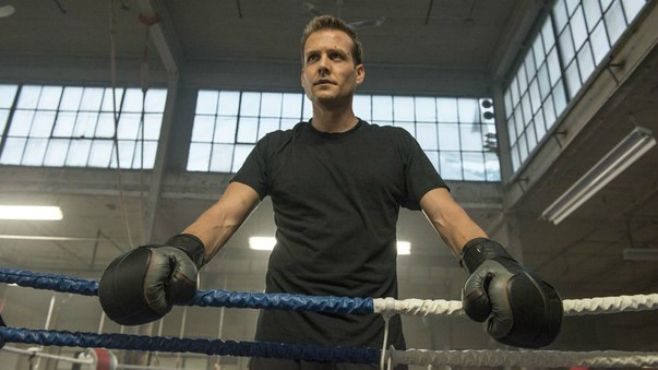 Gabriel Macht wearing black boxing gloves in Suits
