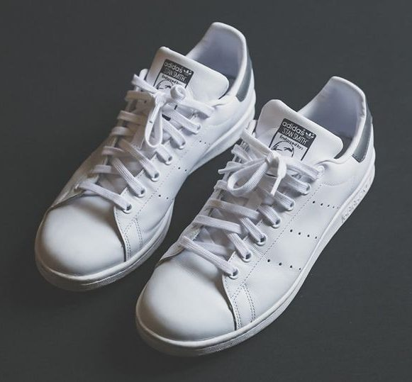 A pair of white Adidas Stan Smith shoes to wear with chinos.