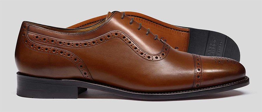 A pair of tan Charles Tyrwhitt shoes with brogue detailing
