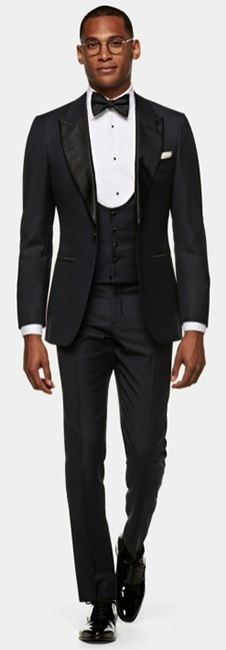 A Suitsupply model wearing a midnight blue tuxedo