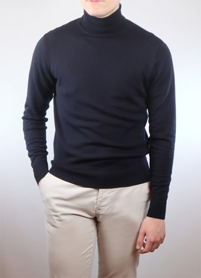 A man wearing a navy roll neck