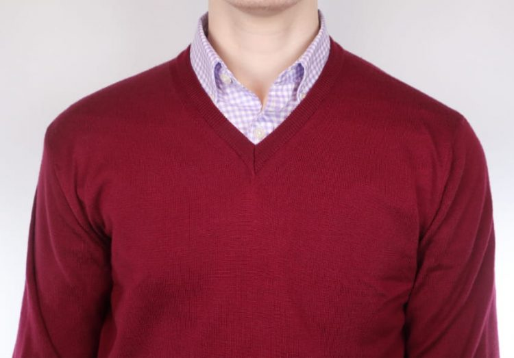 Man wearing a lilac shirt and red sweater outfit combo