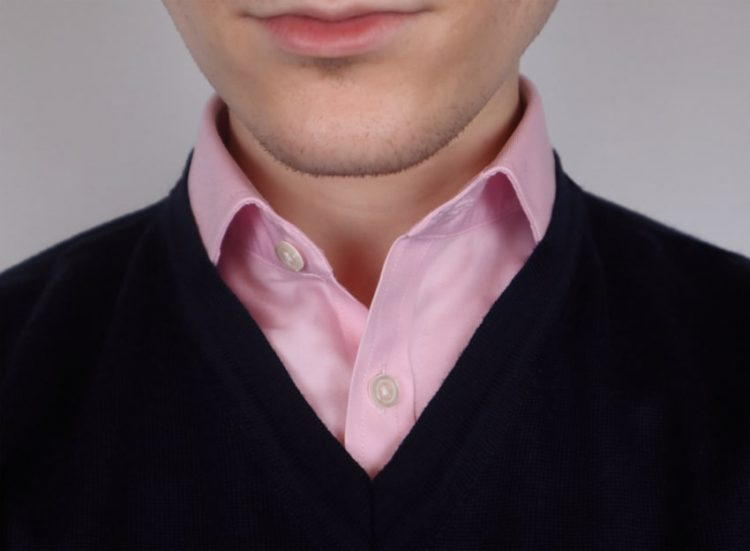 Pink shirt and navy jumper color combination