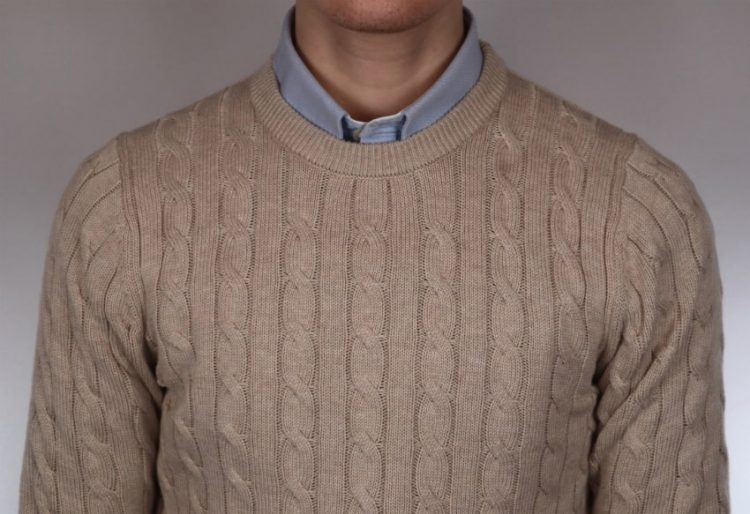 Man wearing a natural sweater and sky blue shirt combination