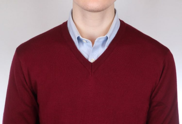 Man wearing a red and sky blue jumper and shirt combo