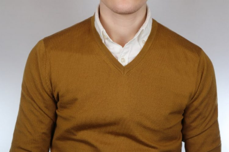 White shirt and mustard pullover outfit