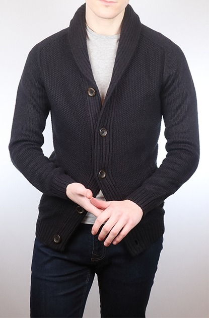 Man in a navy shawl cardigan and indigo jeans