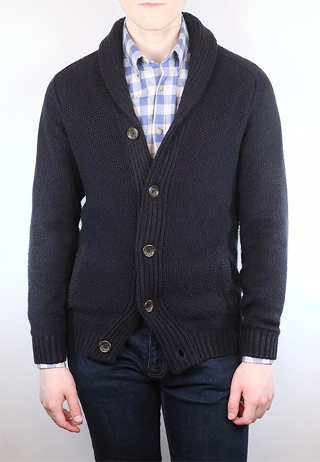 Man wearing a gingham dress shirt with a chunky navy sweater